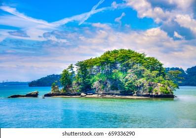Small island and blue sky