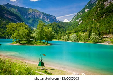 small island in the centre of the beautiful mountain Tenno lake, Trentino, Italy