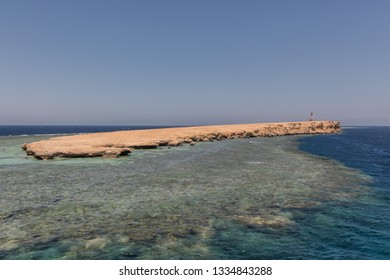 Small island with coral reef