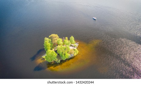 Small island on a sunny day on Nasijarvi lake, Tampere Finland