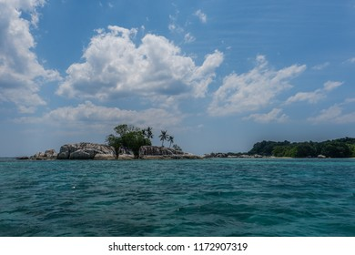 Small island surrounded by blue sea, Belitung, Indonesia.