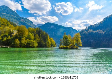 Small island with trees in the lake Koenigssee, Konigsee, Berchtesgaden National Park, Bavaria, Germany.