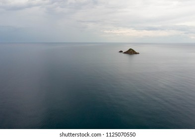 Small islands in calm blue sea of the coast of Tottori, Japan