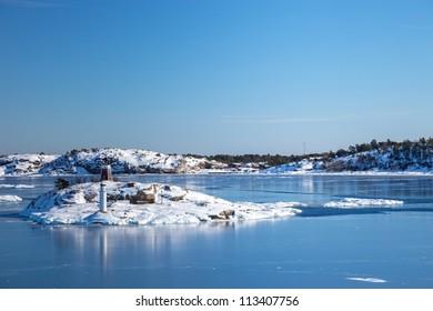 Small islands in the sea in winter scenery. Nynashamn, Sweden.