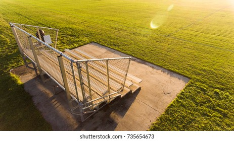small isolated bleacher at soccer stadium at sunrise / sunset