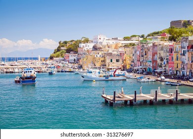 Small Italian town cityscape with colorful houses and piers. Port of Procida island, Gulf of Naples, Italy