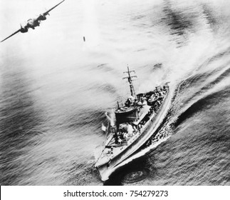 Small Japanese war vessel bombed by U.S. B-25 bomber in the Bismarck Sea, March 21, 1944. The ships crew can be seen running for cover. The ship was sunk by the attack near New Ireland. World War 2