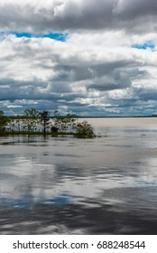 Small jetty at the confluence of the Amazon river and the Rio Maranon and Rio Ucayali
