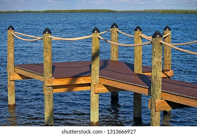 small jetty, wooden platform jetty for pleasure boats in Tampa Bay