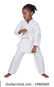 Small karate girl training , isolated on white background