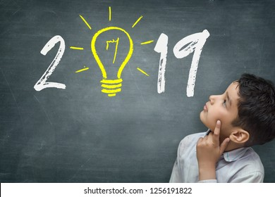 Small kid looking at Goals 2019 on Blackboard