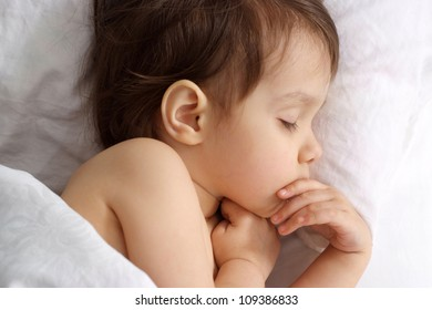 Small kid lying on bed at home