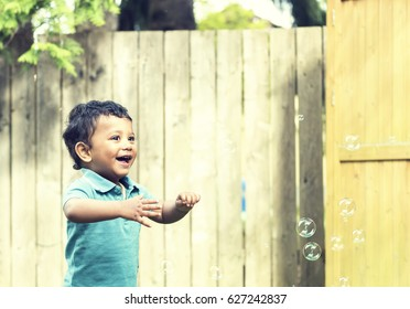 A small kid playing in garden