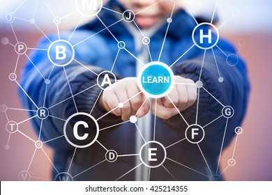 Small kid pressing learn icon on digital touch screen among alphabet letters. Alphabet learning concept.