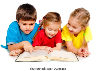 small kids lie on the floor with a book against white
