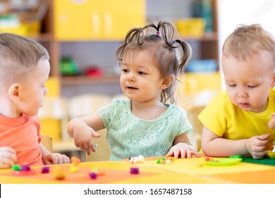 Small kids play on lesson in kindergarten