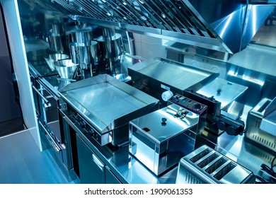 Small kitchen restaurant. Equipment in the restaurant is made of stainless steel. Concept of a mobile cafe. Restaurant kitchen on wheels with industrial equipment. Equipment for cafe on wheels - Shutterstock ID 1909061353