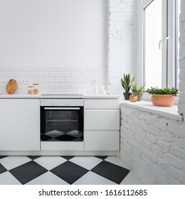 Small kitchen with white brick wall and chess mosaic tiles