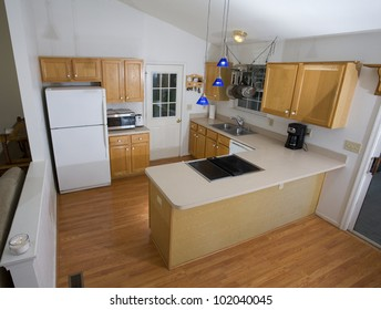 Small kitchen with wood looking floors on the Blue Ridge of Virginia