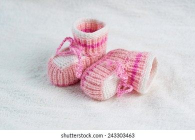 small knitted pink baby boots