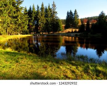 Small lake during the autumn season in Horni Blatna town, Ore Mountains, Czech Republic