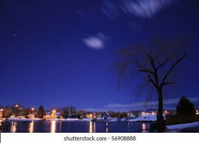 A small lake at a local park in Denver metro area of Colorado on a moon lit night