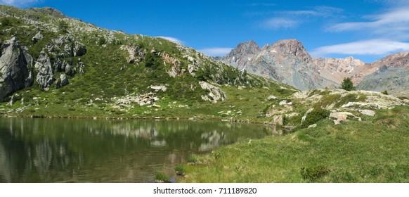 Small lake on the Italian alps in Valmalenco