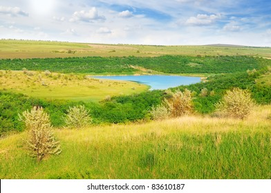 small lake and scenic hills