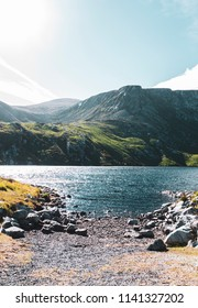 Small lake, surrounded by mountains, taken from the edge at Corrymore on Achill Island, Ireland in summer.