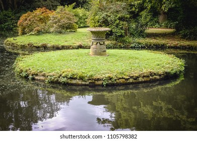 Small lake in Swiss Garden in Old Warden Park located in Biggleswade on the River Ivel in Bedfordshire, England