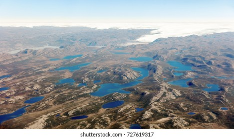 Small lakes appearing on the ice dome of Greenland in the area between Narsarsuaq and Frederikshab. This is a consequence of the phenomenon of global warming and catastrophic thawing of ice