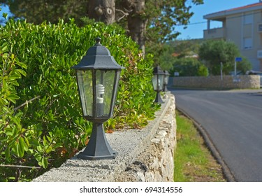 Small lamps as streetlights along the road