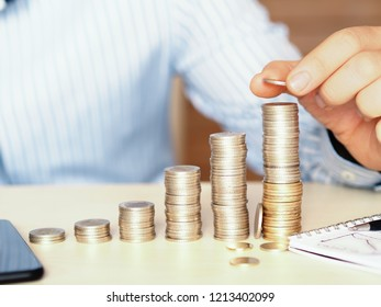 Small to large towers made with coins. financial koncept photo showing increase