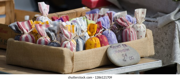 small lavender bags on the local market Rustrel town  provence france. Words sachet de lavandin mean a bag of lavander