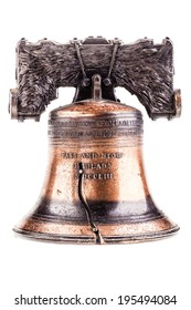 a small liberty bell reproduction isolated over a white background