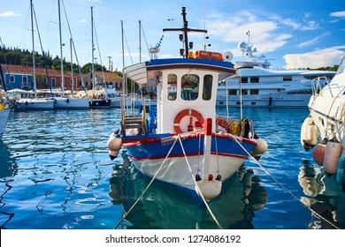 Small life-saver boat in Fiscardo bay, Kefalonia, Ionian Islands, Greece
