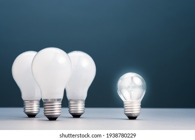 Small light bulb has own light and more brighter than the group of big ones, small business in competition idea, coaching or success training concept