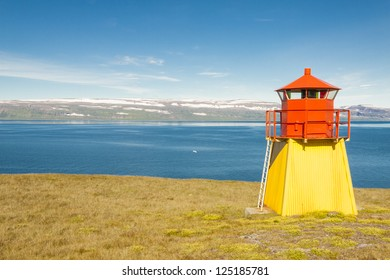 Small lighthouse in Arnarnes near Isafjordur town - Iceland, Westfjords.