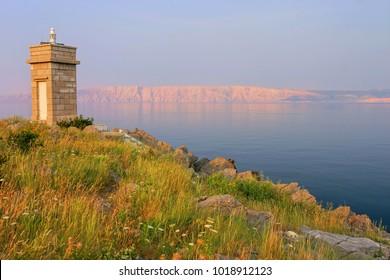 Small lighthouse on the Adriatic sea at dawn (Croatia, Hrvatska, Kroatien)