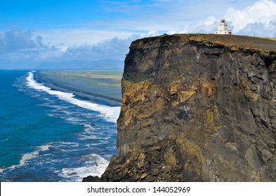 Small lighthouse on the cliff at the cape Dyrholaey, Iceland