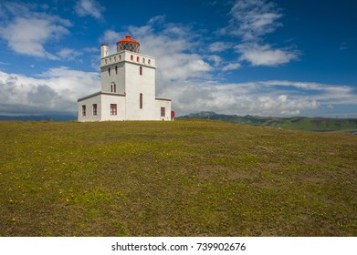 Small lighthouse on the cliff at Dyrholaey cape near Vik, the south of Iceland.