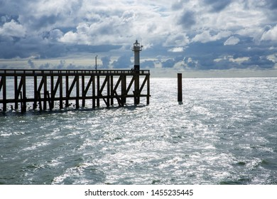 Small lighthouse on a pier near Blankenberge, Flanders, Belgium