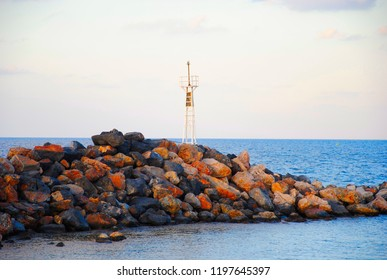 small lighthouse at the port of Sissi on Crete in Greece