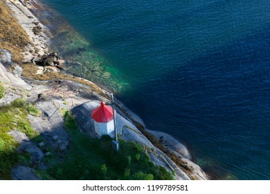 small lighthouse with red roof, tiny house, north of Norway, beautiful water , coast line