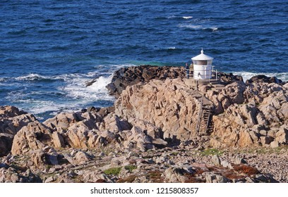 A small lighthouse and the rough nature seen on a sunny day in Kullaberg or Kullen which is a peninsula and nature reserve close to the town of Mölle in southwest Sweden.