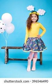 Small little beautiful pretty cute girl dark hair hat with flowers wear fashion style trend clothing dress skirt blouse shoe smile play with bench and balloons dance jump children kid happy daughter