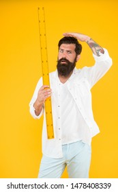 Small little big large. Does size really matter. One meter. Man bearded hipster holding ruler. Measure length. Size tall and length. Big size. Measure. Geometry theorem. Actual size. School teacher.