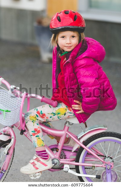 e7ccfda3cce small little cute blond girl learning to ride cycle. Preschooler doing her  first attempts on