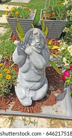 small little statue in a garden