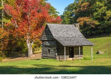 A small log cabin located along the Blue Ridge Parkway near Blowing Rock North Carolina